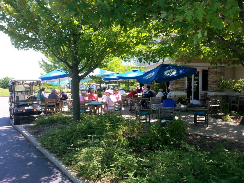 golfers gathered on patio for event at Whisper Creek Golf Club