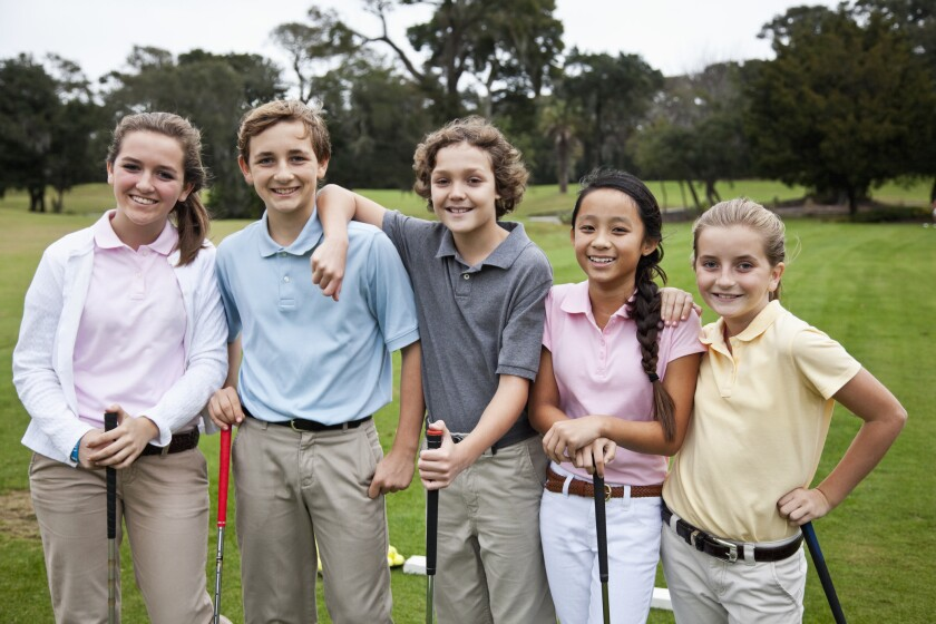 Group of children on golf driving range - junior boys and girls - kids play free