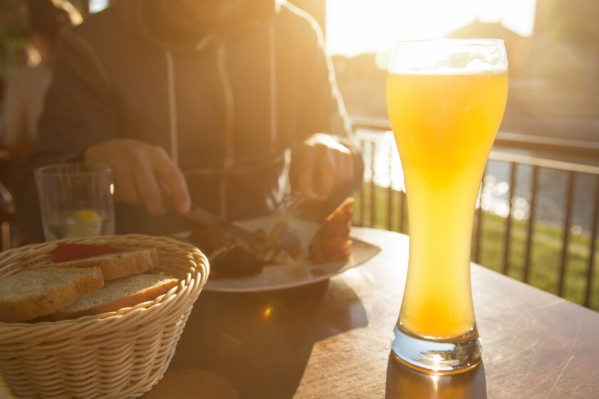 sunset meal with tall beer in sunlight