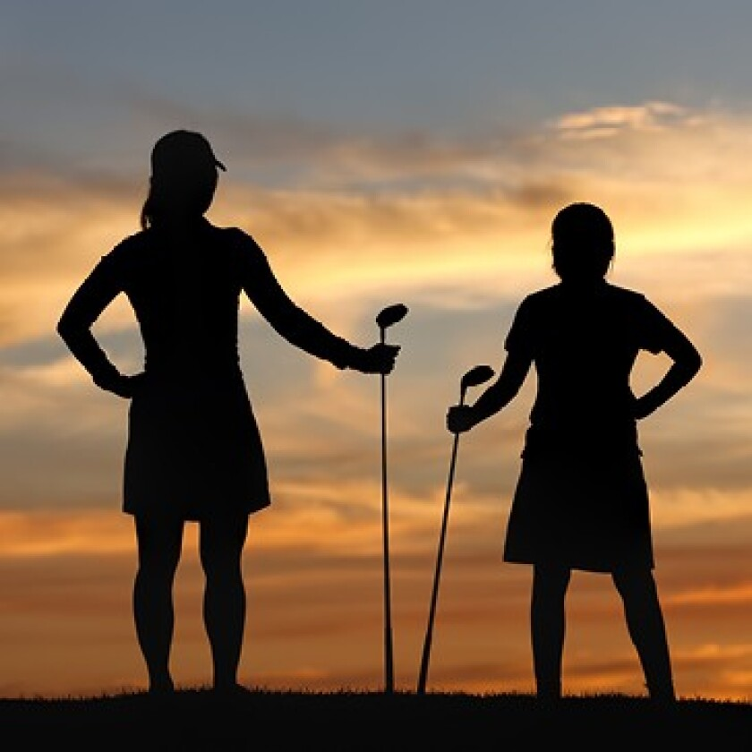 Two Women Golfers at Sunset