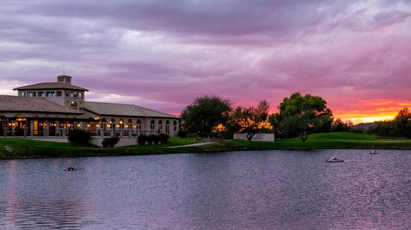 Arizona National clubhouse on lake with sunset