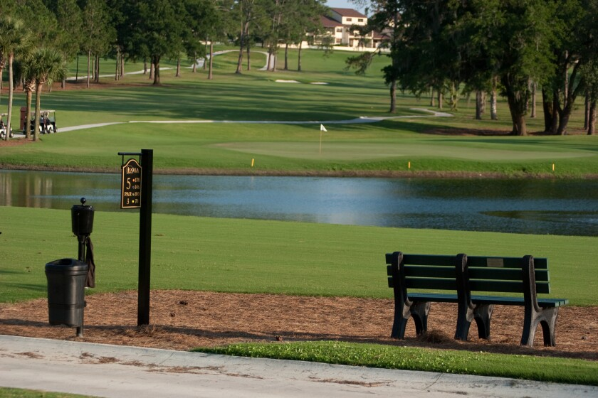 Ocala Golf Club course pond and bench