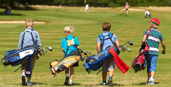 junior golfers walking golf course