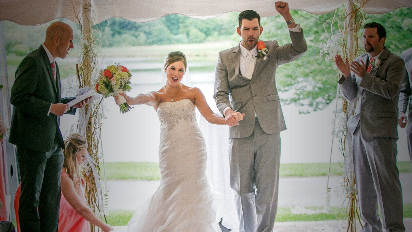 bride and groom celebrate after ceremony at wedding at Orchard Valley Golf Course