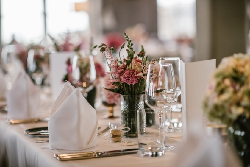 Banquet Event Table Set Up - flowers napkins glasses table setting