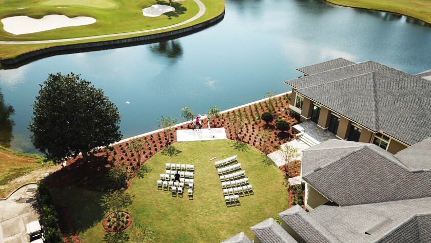 Wedding ceremony set up outside at St Johns golf and country club