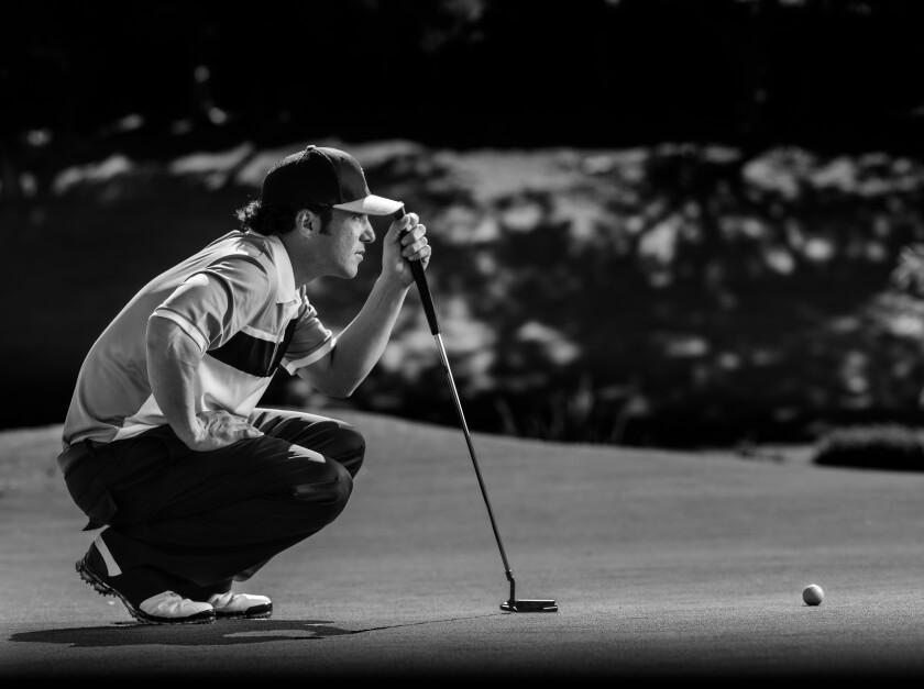 Single Male Golfer on putting green