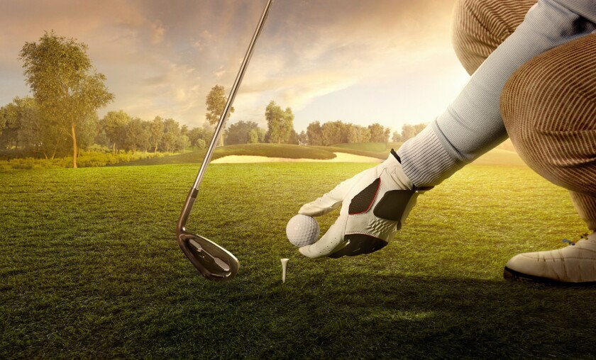 teeing up at the golf course