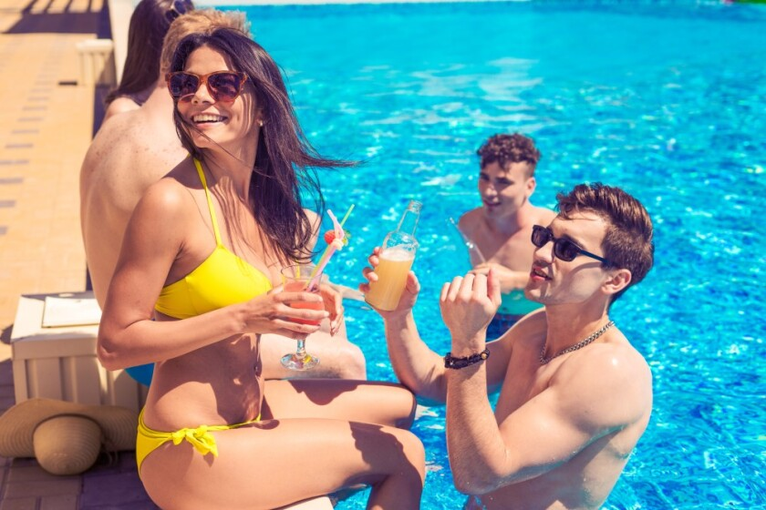 people drinking at the pool