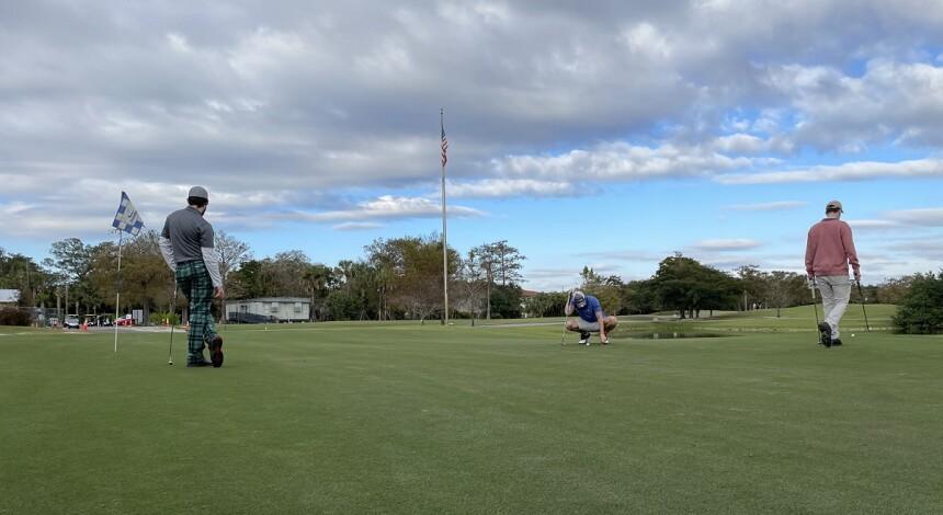golfers putting at Colony West Golf Club