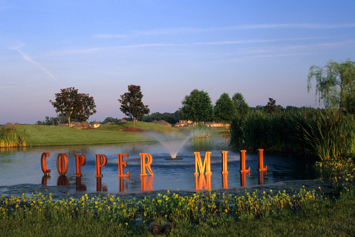 Copper Mill Golf Club entrance sign on lake