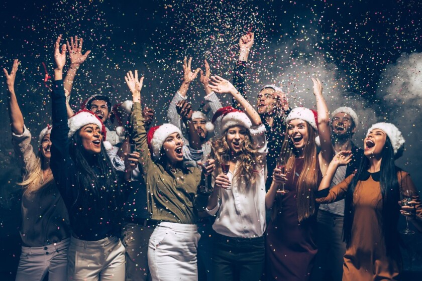 Group of people at a Holiday Christmas Party celebrating