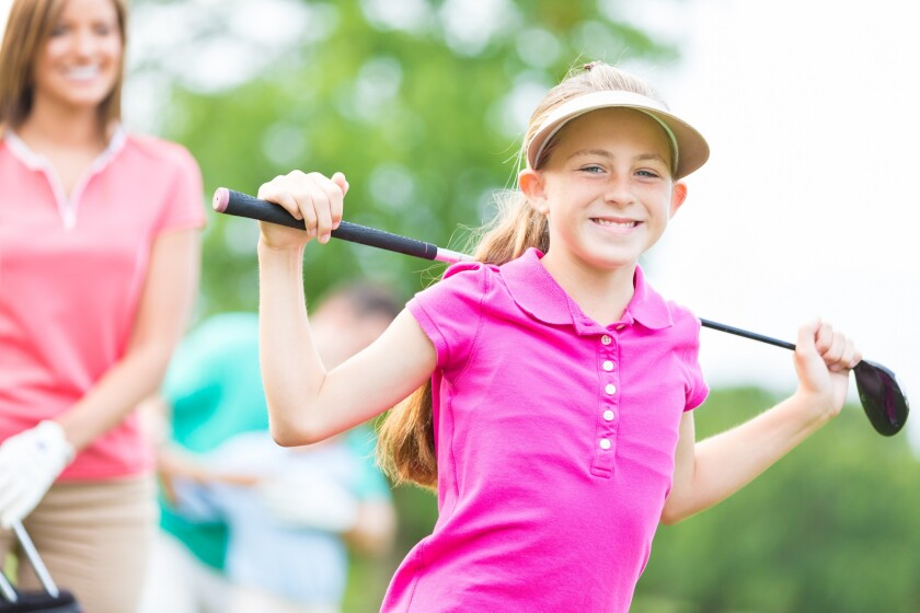 Junior Golfer Smiling on the golf course