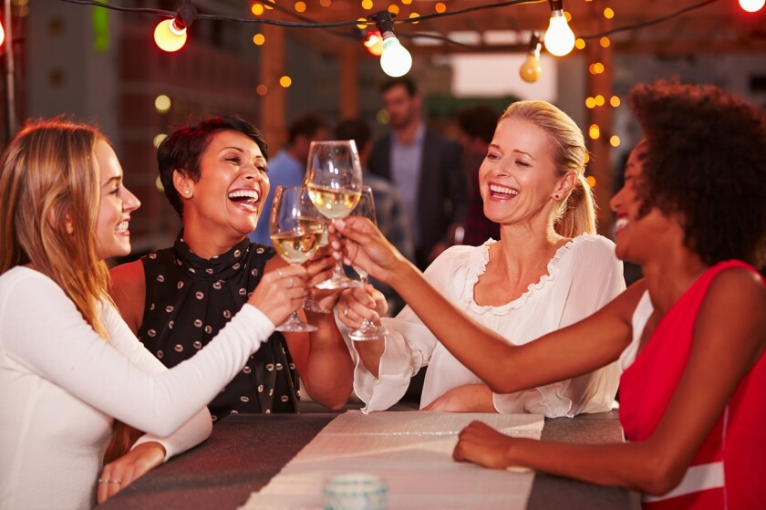 ladies cheers wine at restaurant