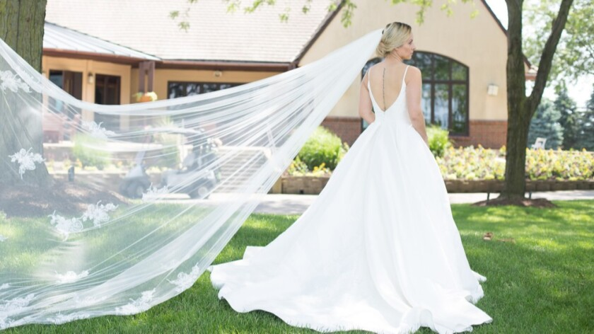 Bride with Long Veil by Clubhouse Orchard Valley Golf Course Wedding