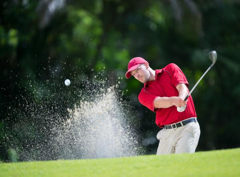 Single Male Golfer playing shot