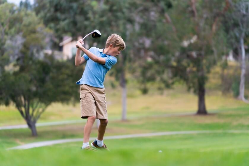9 Year Old  Boy Golfing