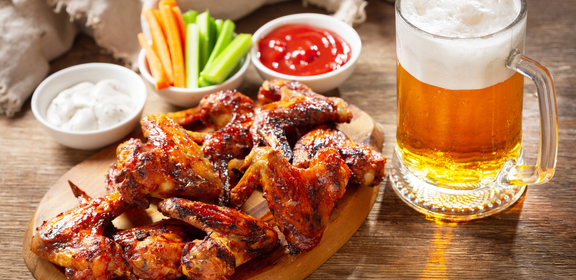 plate of grilled chicken wings and mug of beer