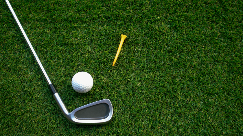 golf club, ball and tee laying on grass
