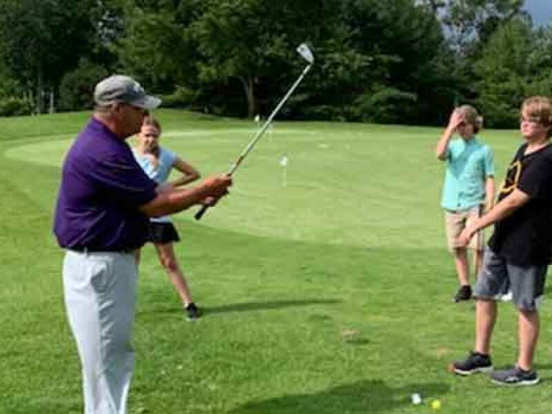Buzz DiSalvo at Raintree teaching junior golfers