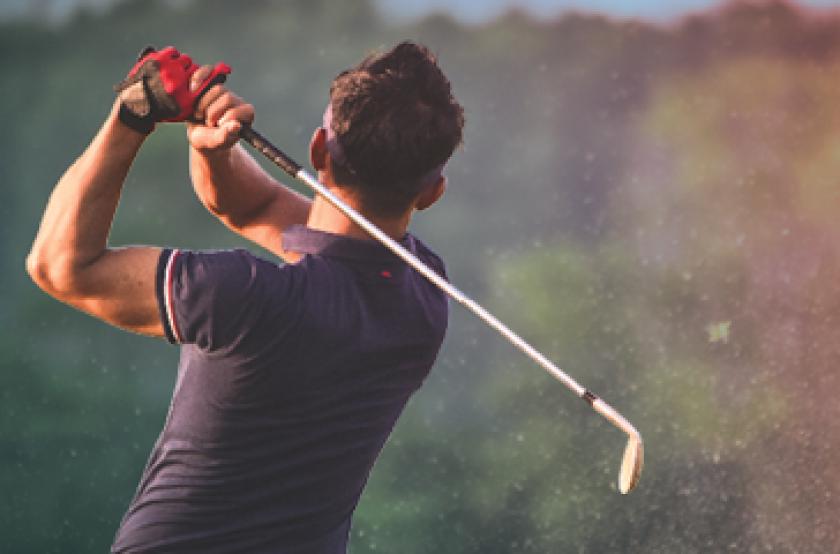 golf swing during sunrise or sunset