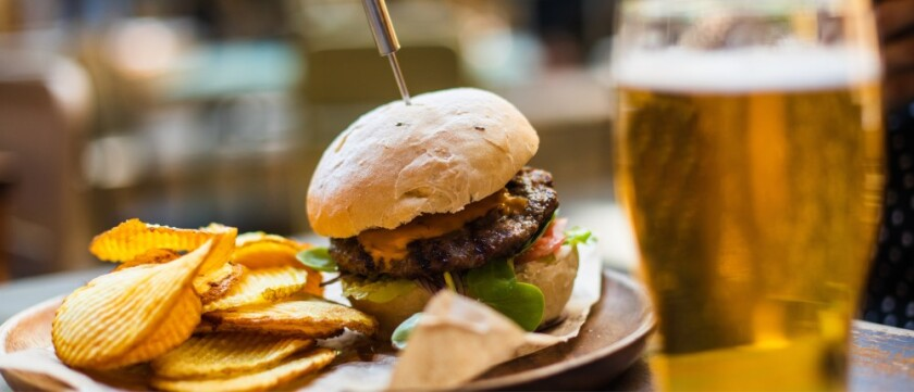 burger with beer and ruffle chips
