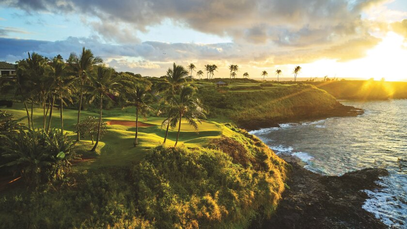 golfers on course at Ocean Course at Hokuala in Lihue, Hawaii