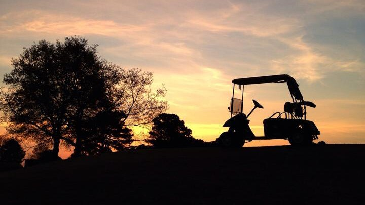 golf cart on course at sunset