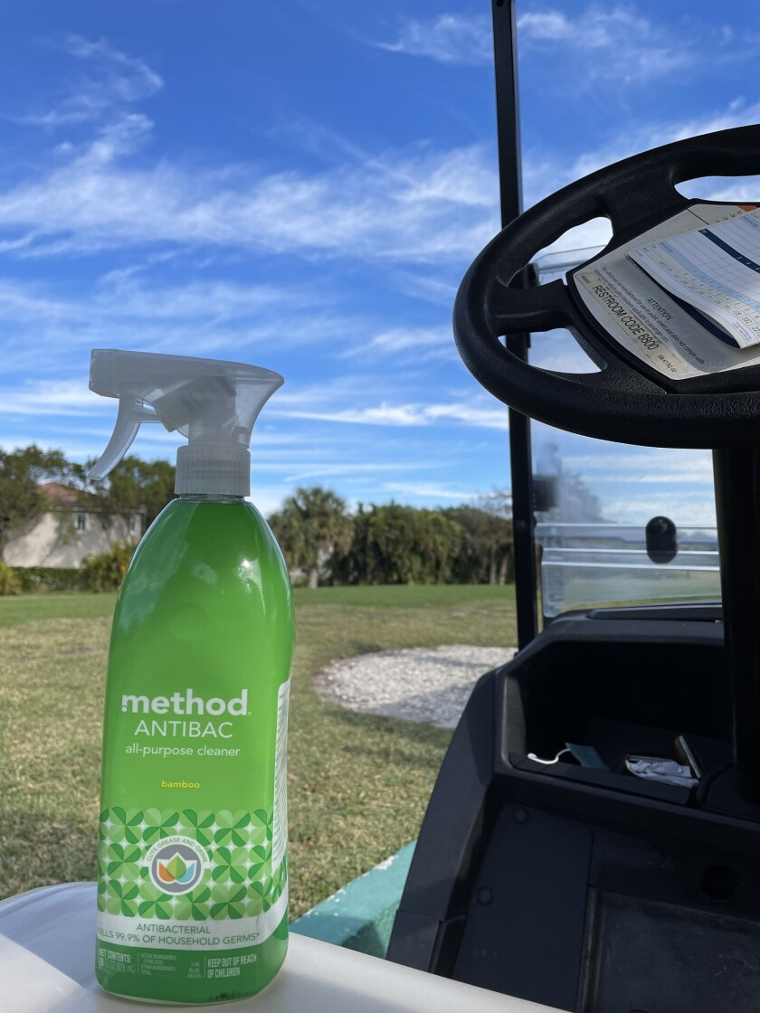 sanitizer on golf cart at Colony West Golf Club in Tamarac, Florida