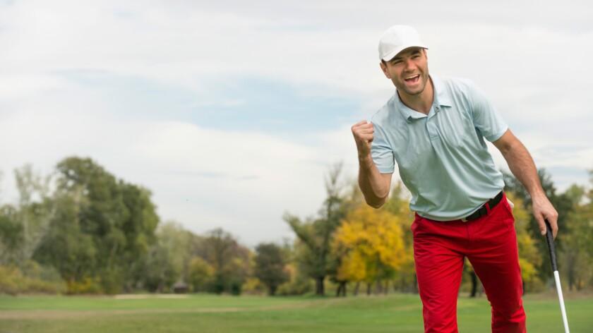 Single Male Golfer celebrating