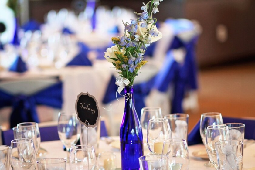 purple vase and table set up from banquet at Orchard Valley Golf Course