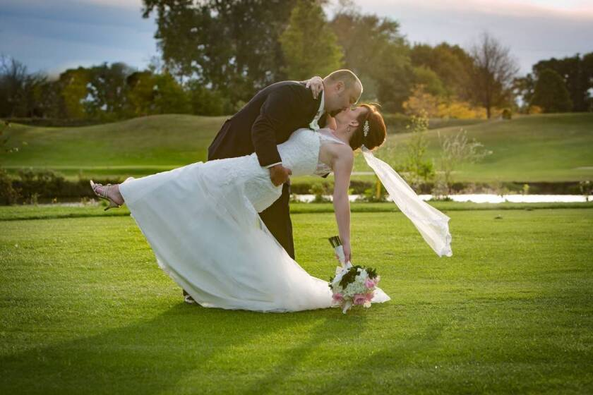 bride and groom dip on golf course at Fellows Creek Golf Club