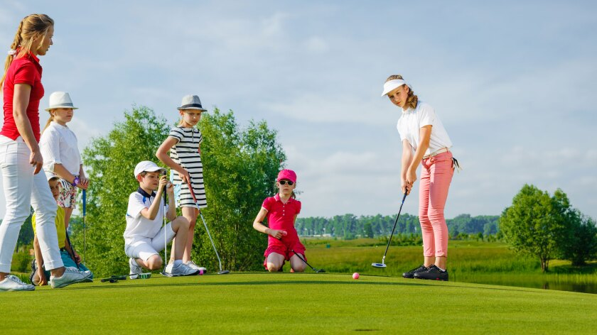 Junior Golfers Playing Golf