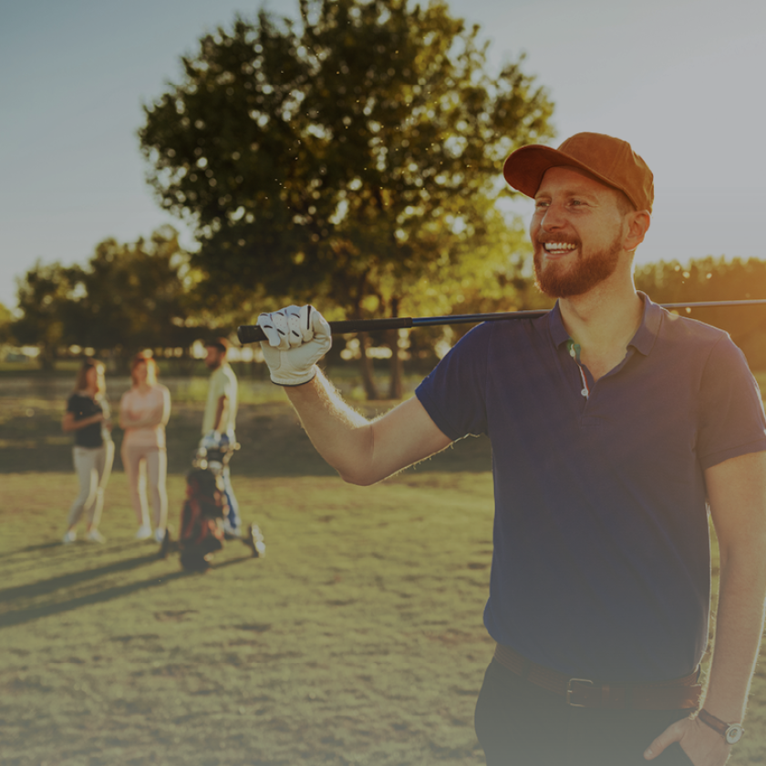 golfer holding golf club - golf course - leagues outings events