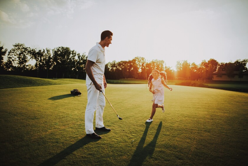 Family playing on golf course